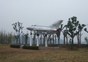 Jet-fighter airplane on a plinth in China 30°43′N 111°17′E