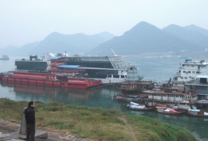 Vessels moored adjacent to the northern bank of the Yangtse river at Yichang, Hubei province in China 30°43′N 111°17′E