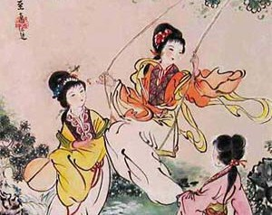 Elegantly-dressed young Chinese women of a time before the twentieth century playing outdoors, one of the swinging on a swing.