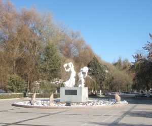 Sculpture of dancing musicians in a park in the centre of Hami, Xinjiang province, China on a sunny day 10th November 2012